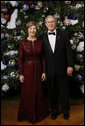 President George W. Bush and Mrs. Laura Bush pose for their 2008 holiday portrait Sunday, Dec. 7, 2008, in the Blue Room of the White House. White House photo by Eric Draper