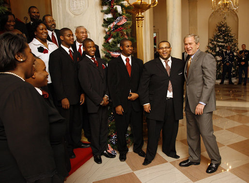 President George W. Bush welcomes members of the musical group Sweet Heaven Kings to the White House, Monday, Dec. 8, 2008, where the musical group performed at the Children's Holiday Reception and Performance. White House photo by Eric Draper