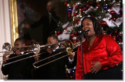 A vocalist with Sweet Heaven Kings entertains in the East Room of the White House Monday, Dec. 8, 2008, during the 2008 Children's Holiday Reception and Performance hosted by President George W. Bush and Mrs. Laura Bush. The Sweet Heaven Kings is the premier brass band at the United House of Prayer in Anacostia, Washington, D.C.  White House photo by Eric Draper