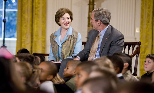 Mrs. Laura Bush and President George W. Bush sit with youngsters Monday, Dec. 8, 2008, during the Children's Holiday Reception and Performance in the East Room of the White House. White House photo by Eric Draper
