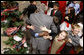 President George W. Bush is smothered in little hands as he says goodbye to a group of childen in attendance Monday, Dec. 8, 2008, for the Children's Holiday Reception and Performance at the White House. The President and Mrs. Laura Bush traditionally invite children to a White House celebration for the holidays, and this year, the audience included kids of active duty and reserve military service members from Russell Elementary at Quantico Marine Base, Dahlgren School at Dahlgren Navy Base and West Meade Elementary at Ft. Meade Army Base. White House photo by Eric Draper