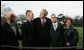 President George W. Bush pauses to greet Marine Lance Cpl. Patrick Paul Pittman Jr., left, and Lance Cpl. Marc E. Olson, both wounded in Operation Iraqi Freedom, as he arrived on the South Lawn of the White House Tuesday, Dec. 9, 2008, after spending the day at West Point. With them are Patrick Paul Pittman Sr., father of Lance Cpl. Pittman, and Janice Kloski, mother of Lance Cpl. Olson. White House photo by Joyce N. Boghosian