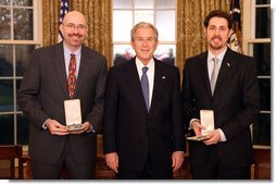 President George W. Bush stands with Mike Feinberg and Dave Levin after presenting them with the 2008 Presidential Citizens Medal Wednesday, Dec. 10, 2008, in the Oval Office of the White House. White House photo by Chris Greenberg