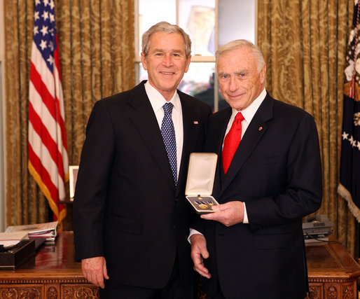 President George W. Bush stands with Arnold Fisher after presenting him with the 2008 Presidential Citizens Medal Wednesday, Dec. 10, 2008, in the Oval Office of the White House. White House photo by Chris Greenberg