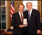 President George W. Bush stands with Ward Brehm after presenting him with the 2008 Presidential Citizens Medal Wednesday, Dec. 10, 2008, in the Oval Office of the White House. White House photo by Chris Greenberg