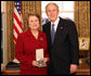 President George W. Bush stands with Dr. Anne M. Radice after presenting her with the 2008 Presidential Citizens Medal Wednesday, Dec. 10, 2008, in the Oval Office of the White House. White House photo by Chris Greenberg