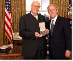 President George W. Bush stands with Forrest M. Bird after presenting him with the 2008 Presidential Citizens Medal Wednesday, Dec. 10, 2008, in the Oval Office of the White House. White House photo by Chris Greenberg