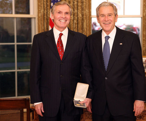 "President George W. Bush stands with Raymond ""Ray"" Chambers after presenting him with the 2008 Presidential Citizens Medal Wednesday, Dec. 10, 2008, in the Oval Office of the White House. White House photo by Chris Greenberg"