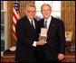 President George W. Bush stands with Chuck Colson after presenting him with the 2008 Presidential Citizens Medal Wednesday, Dec. 10, 2008, in the Oval Office of the White House. White House photo by Chris Greenberg