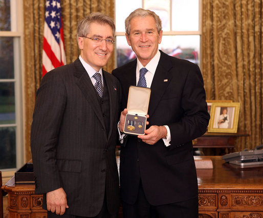 "President George W. Bush stands with Robert ""Robby"" P. George after presenting him with the 2008 Presidential Citizens Medal Wednesday, Dec. 10, 2008, in the Oval Office of the White House. White House photo by Chris Greenberg"