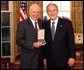 President George W. Bush stands with Sam Heyman after presenting him with the 2008 Presidential Citizens Medal Wednesday, Dec. 10, 2008, in the Oval Office of the White House. White House photo by Chris Greenberg