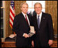 President George W. Bush stands with Dr. Don Landry after presenting him with the 2008 Presidential Citizens Medal Wednesday, Dec. 10, 2008, in the Oval Office of the White House. White House photo by Chris Greenberg