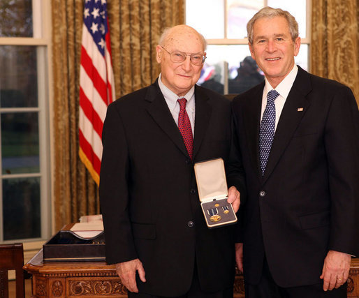 President George W. Bush stands with Andrew Marshall after presenting him with the 2008 Presidential Citizens Medal Wednesday, Dec. 10, 2008, in the Oval Office of the White House. White House photo by Chris Greenberg