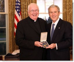 President George W. Bush stands with Father John P. Foley, S.J., after presenting him with the 2008 Presidential Citizens Medal Wednesday, Dec. 10, 2008, in the Oval Office of the White House. White House photo by Chris Greenberg