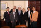 President George W. Bush poses for a photo with international bloggers and new media users following their meeting on human rights Wednesday, Dec. 10, 2008, in the Roosevelt Room at the White House. White House photo by Chris Greenberg