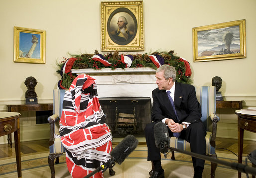 "Marking International ""Human Rights Day,"" President George W. Bush meets with Dr.Halima Bashir, a Darfur Human Rights Activist in the Oval Office of the White House. President Bush said Dr. Bashir, the author of ""Tears of the Desert,"" ""This good soul brings firsthand accounts to what life is like in Darfur. She has witnessed violence, deprivation, and she carries a message of a lot of people who want our help."" White House photo by Chris Greenberg"
