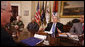 President George W. Bush speaks to participants during a meeting on drug use reduction Thursday, Dec. 11, 2008, in the Roosevelt Room of the White House. Listening in are, from left: Lt. Mike Boudreaux, Narcotics Commander, Tulare County Sheriff's Department, Visalia, Calif.; Janice Dessaso Gordon, co-founder, Community Action Group, Washington, D.C., and Josh Hamilton, outfielder with the Texas Rangers. John Walters, Director of the Office of National Drug Control Policy, is in foreground at left. White House photo by Chris Greenberg