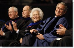 President George W. Bush enjoys the moment with his mom, Mrs. Barbara Bush, and dad, former President George H.W. Bush, as they sit on stage at Reed Arena on the campus of Texas A&M University where the President addressed the 3,700 graduates of the school's Winter Class of 2008.  White House photo by Eric Draper
