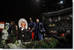 President George W. Bush waves as he leaves the stage following his commencement address at Texas A&M University's winter convocation Friday, Dec. 12, 2008, in College Station, Texas. White House photo by Eric Draper