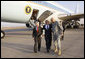 President George W. Bush is greeted to Baghdad International Airport by U.S. Ambassador to Iraq Ryan Crocker, left, and U.S. Commander in Iraq, General Ray Odierno, Sunday, Dec. 14, 2008 in Baghdad, where President met with Iraqi leaders and visited with U.S. military personnel. White House photo by Eric Draper