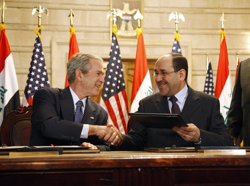 "President George W. Bush and Iraqi Prime Minister Nuri al-Maliki shake hands following the signing of the Strategic Framework Agreement and Security Agreement at a joint news conference Sunday, Dec. 14, 2008, at the Prime Minister's Palace in Baghdad. President Bush said, "" The agreements represent a shared vision on the way forward in Iraq."" White House photo by Eric Draper"
