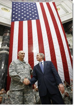 President George W. Bush stands on stage with U.S. Commander in Iraq, General Ray Odierno, Sunday, Dec. 14, 2008, following his address to U.S. military and diplomatic personnel at the Al Faw Palace-Camp Victory in Baghdad.  White House photo by Eric Draper