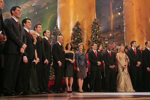 Mrs. Laura Bush joins Dr. Phil McGraw and his wife Robin, center-left, along with stage performers Sunday, Dec. 14, 2008, during the annual Christmas in Washington performance at the National Building Museum in Washington D.C. White House photo by Joyce N. Boghosian