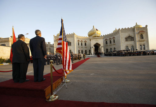 President George W. Bush stands with Iraq's President Jalal Talabani during a welcoming ceremony Sunday, Dec. 14. 2008, to the Salam Palace in Baghdad, where President Bush met with Iraq's leadership. White House photo by Eric Draper