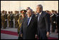 President George W. Bush walks with Iraq's President Jalal Talabani folowing his review of an honor guard upon his arrival Sunday, Dec. 14. 2008 to the Salam Palace in Baghdad, where President Bush met with Iraq's leadership. White House photo by Eric Draper