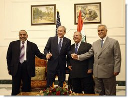 President George W. Bush poses for photos with Iraq's President Jalal Talabani, left, and Iraq Vice Presidents Adil Abdul-Mahdi and Tariq al-Hashimi, right, during their meeting Sunday, Dec. 14. 2008, at the Salam Palace in Baghdad.  White House photo by Eric Draper