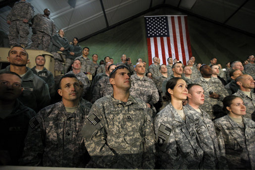 "Troops at Bagram Air Base listen to remarks by President George W. Bush early Monday, Dec. 15, 2008, after his arrival in Afghanistan. The President told his audience, ""I am confident we will succeed in Afghanistan because our cause is just, our coalition and Afghan partners are determined; and I am confident because I believe freedom is a gift of an Almighty to every man, woman, and child on the face of the Earth. Above all, I know the strength and character of you all. As I conclude this final trip, I have a message to you, and to all who serve our country: Thanks for making the noble choice to serve and protect your fellow Americans."" White House photo by Eric Draper"