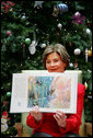 "Mrs. Laura Bush shows off the illustrations in ""My Penguin Osbert"" Monday, Dec. 15, 2008, which she read to young patients and their families at Children's National Medical Center in Washington, D.C. Mrs. Bush explained that the book is about what you do when you write Santa a letter. Mrs. Bush also visited with patients and debuted the new Barney Cam VII: A Red, White & Blue Christmas for the kids. White House photo by Joyce N. Boghosian"