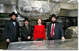 Mrs. Laura Bush poses Monday, Dec. 15, 2008, in the White House kitchen with the rabbis who supervised the kitchen's koshering for the annual Hanukkah party. From left are Rabbi Mendel Minkowitz, Rabbi Binyomin Steinmetz and Rabbi Levi Shemtov. White House photo by Joyce N. Boghosian