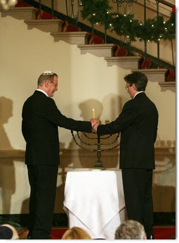Clifton Truman Daniel, right, and Yariv Ben-Eliezer light the Menorah Monday, Dec. 15, 2008, before the annual White House Hanukkah Reception. Because the Menorah was being lit before the holiday actually begins, December 21, all eight candles, plus the Shamash -- the main candle -- were lit following a blessing.  White House photo by Shealah Craighead