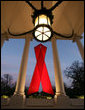 A red ribbon adorns the North Portico of the White House Friday, Nov. 30, 2007, in recognition of World AIDS Day and the commitment by President George W. Bush and his administration to fighting and preventing HIV/AIDS in America. White House photo by Eric Draper