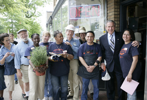 President George W. Bush stands with employees during a visit to Frager's Hardware store in the Capitol Hill neighborhood of Washington, D.C., Friday, May 5, 2006. White House photo by Eric Draper