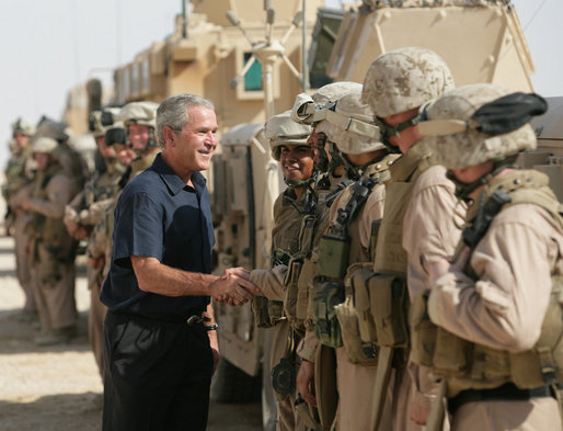 President George W. Bush visits with U.S. troops upon his arrival Sept. 3, 2007, in Al Anbar Province, Iraq. White House photo by Eric Draper
