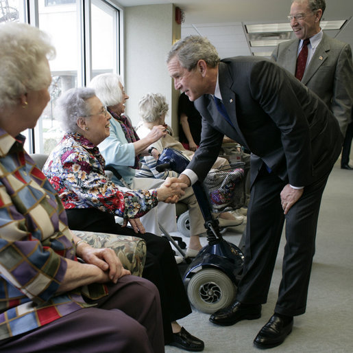 President George W. Bush and Senator Charles, Grassley, R-Iowa, greet residents at Wesley Acres Senior Center in Des Moines, Iowa, Tuesday, April 11, 2006. The President visited Iowa to talk about the Medicare prescription drug benefits. White House photo by Eric Draper