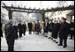 President George W. Bush stands with President Hamid Karzai of Afghanistan as he prepares to depart Kabul Monday, Dec. 15, 2008, for Washington, D.C. The President arrived in Afghanistan in the pre-dawn hours to deliver farewell remarks to the troops at Bagram Air Base and to meet with President Karzai. White House photo by Eric Draper