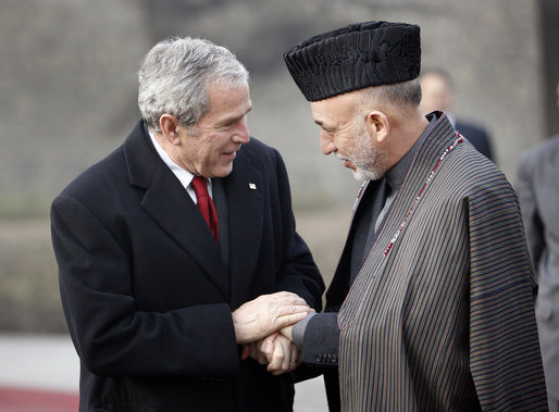 President George W. Bush bids farewell to President Hamid Karzai of Afghanistan as he prepares to depart the presidential palace Monday, Dec. 15, 2008, in Kabul. White House photo by Eric Draper