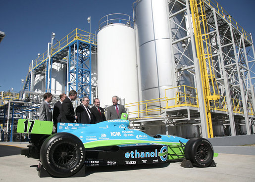 President George W. Bush is joined by officials from Novozymes North America, Inc. Wednesday, Feb. 22, 2007, as he is shown a race car that is fueled by ethanol, during his tour of the Novozymes, a biotechnology facility in Franklinton, N.C. White House photo by Paul Morse