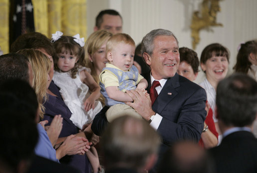 President George W. Bush holds 14-month-old Trey Jones of Cypress, Texas, following his remarks about stem cell research policy legislation in the East Room of the White House Wednesday, July 19, 2006. White House photo by Kimberlee Hewitt