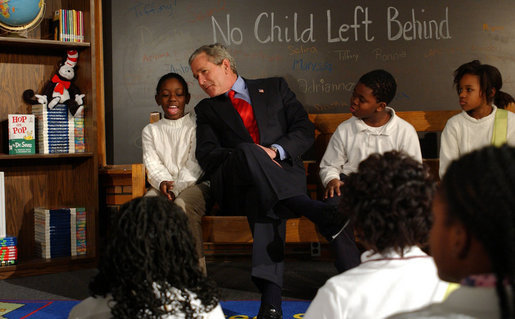 President George W. Bush talks to fourth-graders during a visit January 5, 2004, to the Pierre Laclede Elementary School in St. Louis. White House photo by Tina Hager