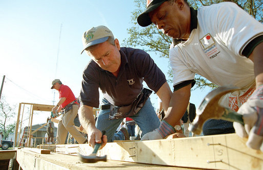 President George W. Bush helps raise a house during a visit June 5, 2001, to a Habitat for Humanity location in Tampa. White House photo by Eric Draper