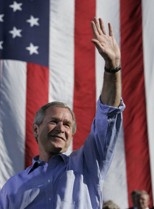 President George W. Bush waves after remarks Sept. 23, 2004, at a Victory 2004 rally in Bangor, Maine. White House photo by Paul Morse