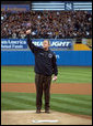 President George W. Bush gives a thumbs-up as he stands on the mound at Yankee Stadium Oct. 30, 2001, before throwing out the ceremonial first pitch in Game Three of the World Series between the Arizona Diamondbacks and the New York Yankees. White House photo by Eric Draper