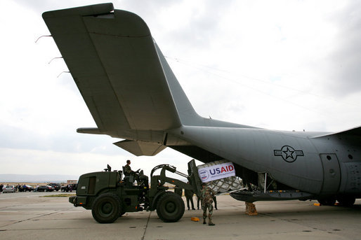 A U.S. Army crew offloads USAID humanitarian supplies from a C-130 aircraft Thursday, Sept. 4, 2008 during a visit by Vice President Dick Cheney to a U.S. relief operation center at Tbilisi International Airport, Georgia. Through U.S. relief efforts, Georgians affected by the recent Russian aggression are receiving cots, blankets, food rations and hygiene packs. White House photo by David Bohrer