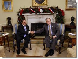 President George W. Bush and President Antonio Saca of El Salvador shake hands as they meet Tuesday, Dec. 16, 2008, in the Oval Office of the White House.  White House photo by Eric Draper