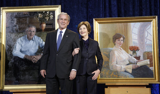 President George W. Bush and Mrs. Laura Bush stand in front of their portraits Friday, Dec. 19, 2008, after the unveiling at the Smithsonian's National Portrait Gallery in Washington, D.C. The portrait of Mrs. Bush was done by Aleksander Sasha Titovets; the Presidential portrait was done by Robert Anderson. White House photo by Eric Draper