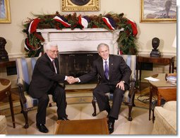 President George W. Bush welcomes President Mahmoud Abbas of the Palestinian Authority Friday, Dec. 19, 2008, to the Oval Office of the White House. White House photo by Eric Draper